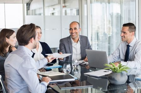 stock-photo-business-man-passing-over-documents-to-leader-during-meeting-businessman-passing-agreement-to-the-785828815_1.jpg